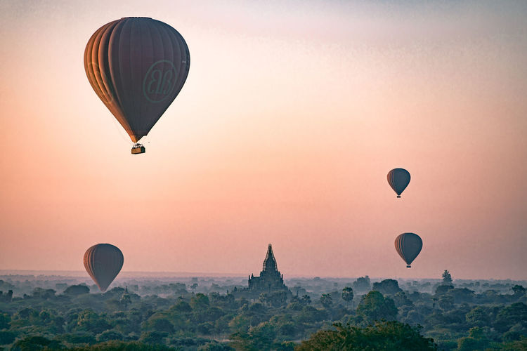 Adventure Air Vehicle Balloon Ballooning Festival Beauty In Nature Flying Hot Air Balloon Landscape Mid-air Mode Of Transportation Nature No People Outdoors Scenics - Nature Sky Sun Sunset Tourism Transportation Travel Travel Destinations