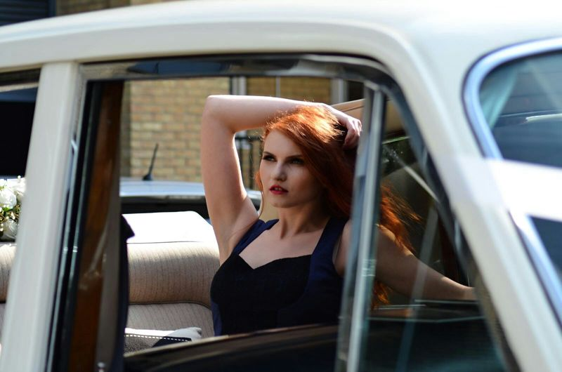 Car Transportation Mode Of Transport Window Lifestyles Portrait One Woman Only Adult Hairstyles Coutures Dressed To Impress Fashion Model Fashion Human Lips Model Life Beauty In Nature Glamour Dresses Desinger Well-dressed Beautiful Woman Magazine Redhead Day Standing Human Hair