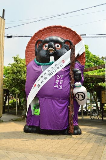 Raccoon Dog Chimpanzee Day Outdoors Well-dressed Adult One Man Only Only Men City Tree Baboon People Mammal Sky 信楽 信楽駅 狸 Phone Box BIG 公衆電話 Station Shigaraki 忍者 Ninja In Shigaraki, raccoon dogs are mass-produced. It is a famous Raccoon dog in Japan. Speaking of raccoon dog is Shigaraki. There is a legend that it is auspicious that there is one at home and shops.