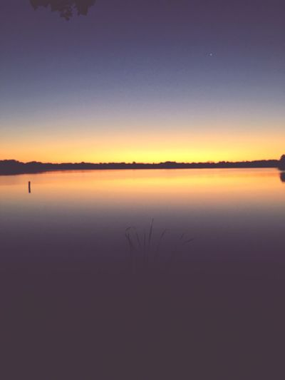 Tranquil Scene Nature Tranquility Sunset Beauty In Nature Scenics Silhouette Water Idyllic Lake Sky Outdoors No People Reflection Clear Sky Landscape Day