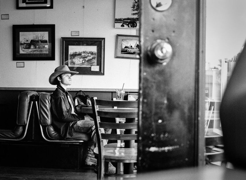 Alone Arizona Black And White Blackandwhite Candid Cowboy Cowboys D Diner Gazing Out The Window Inside Mamiya Man Medium Format Pensive Resturant Route 66 Sitting At Table Small Town Solitude Southwest USA Williams, Arizona
