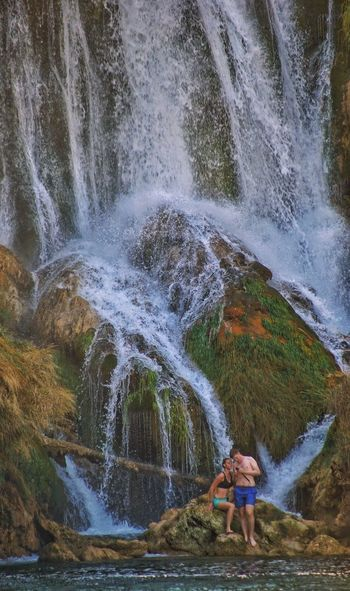 A couple Waterfall Water Motion Rock - Object Beauty In Nature Nature River Scenics Day One Person Outdoors Standing Real People Young Adult Adults Only People Adult