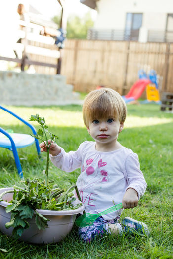 Full length of cute girl on grass