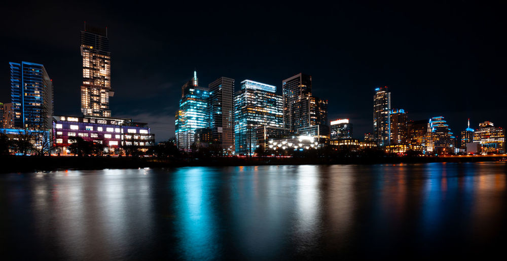 Austin skyline at night reflecting in Lady bird lake Building Exterior Architecture Built Structure City Night Water Illuminated Waterfront Reflection Office Building Exterior Urban Skyline Landscape Skyscraper River Tall - High Cityscape No People Modern Financial District  Nightlife Austin Lady Bird Lake Texas Cityscape America