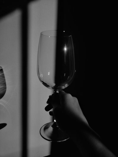 Close-up of hand holding glass of wine