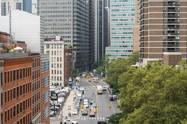 High angle view of traffic on road amidst buildings in city