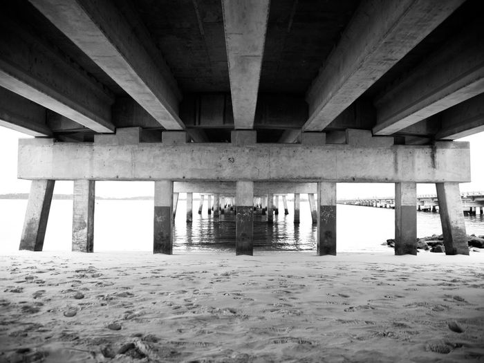 Architecture Built Structure Bridge Bridge - Man Made Structure Architectural Column Underneath Below No People Water Beach Day Sand Nature Pier Concrete Sea Black And White