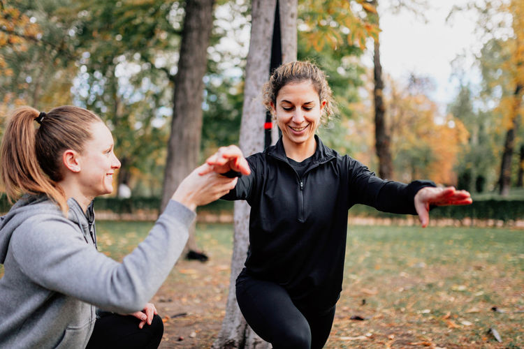 Close-up of women exercising at park