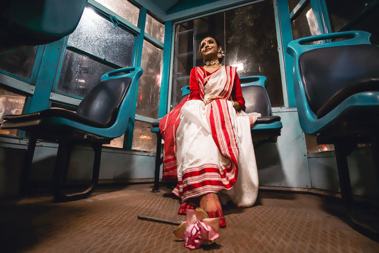 Portrait of woman sitting on seat