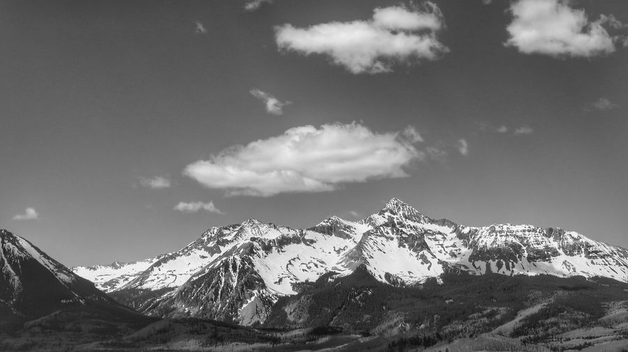 Black and white landscape of distant snow dappled mountain range in Colorado Black And White Colorado San Juan Mountains Sky Cloud - Sky Nature Mountain Beauty In Nature No People Scenics - Nature Day Tranquility Outdoors Tranquil Scene Low Angle View Mountain Range Snow Snowcapped Mountain Mountain Peak