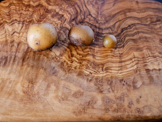 Potato Brown Close-up Directly Above Food Food And Drink Freshness Healthy Eating High Angle View Indoors  Mushroom No People Pattern Raw Food Still Life Table Textured  Vegetable Wellbeing Wood Wood - Material Wood Grain