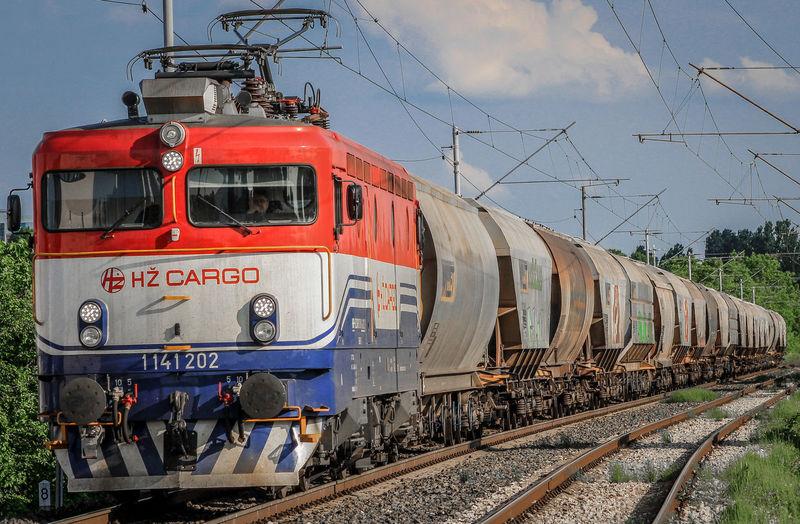 freight train Electric Locomotive Zagreb Zagreb, Croatia Croatia Cargo Train Railroad Track Bird Red Train - Vehicle Sky Locomotive Train Rail Transportation Freight Train Railway Track Train Track