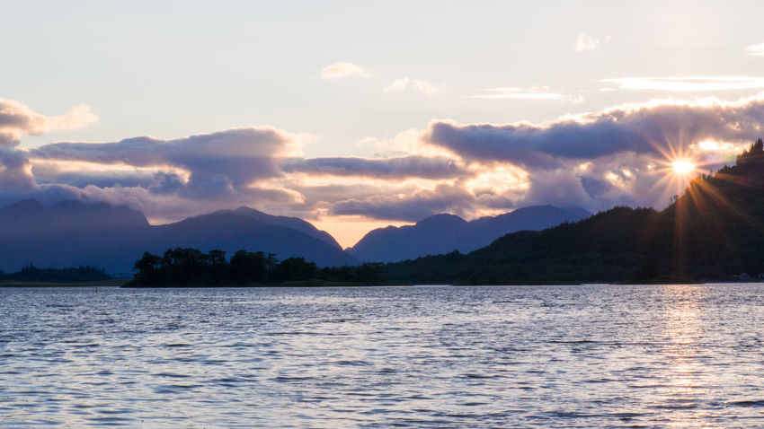 Sunset Over Loch Leven in Glencoe, Scotland Glencoe Loch  Loch Leven Reflection Scotland Beauty In Nature Highlands Lake Mountain Nature No People Outdoors Scenics Scottish Highlands Sky Sunset Symmetry Tranquil Scene Tranquility Water
