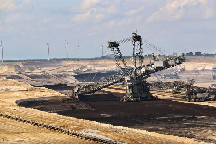 Brown coal surface mining - open cast coal mining. Huge bucket wheel excavator. new developed technology. Supposed to be more environmentally friendly. Bucket Wheel Excavator Cloud - Sky Coastal Feature Day Nature No People Non-urban Scene Open Cast Coal Mining Outdoors Scenics Sky Sunlight Tourism Travel Destinations EyeEm Diversity