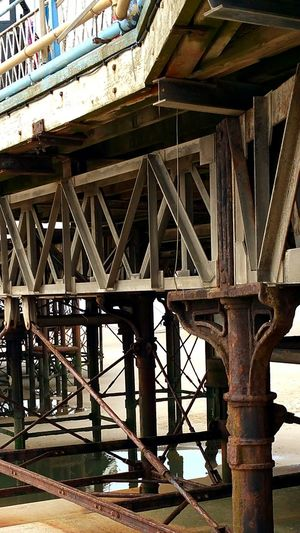 Bridge - Man Made Structure Built Structure Architecture Connection Metal Outdoors Girder Old-fashioned Architectural Column Steel Underneath No People Structure Photography Steel Structure  Framework Steel Structure  Looking Down From Above Architectural Feature Blackpool Central Pier Pier Close-up Architecture