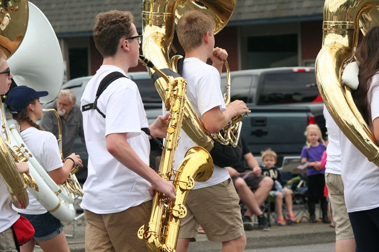 4th Of July 2016 4th Of July Parade Arts Culture And Entertainment Casual Clothing Celebration Enjoyment Friendship Fun Holding Leisure Activity Lifestyles Marching Band Musical Instruments Patriotism Photographing Playing Saxaphone Skill  Tuba