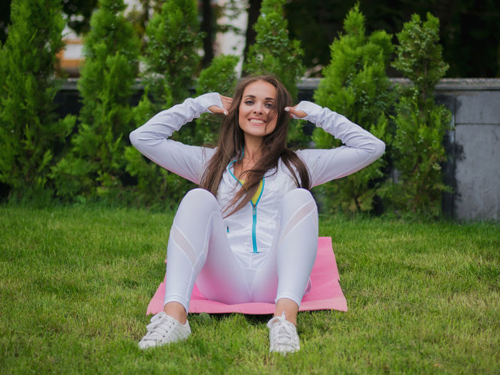 Portrait Of Happy Of Mid Adult Woman Exercising At Park
