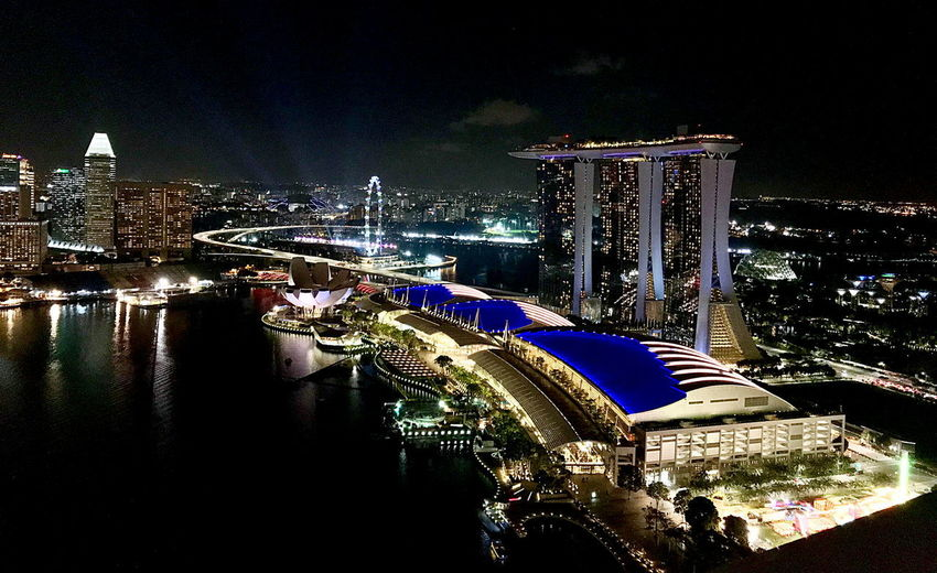 Architecture Built Structure Night Building Exterior Water Illuminated City Travel Destinations Sky River No People Tourism Transportation Travel Building Reflection Bridge Modern Outdoors Office Building Exterior Skyscraper Cityscape Luxury Nightlife Singapore