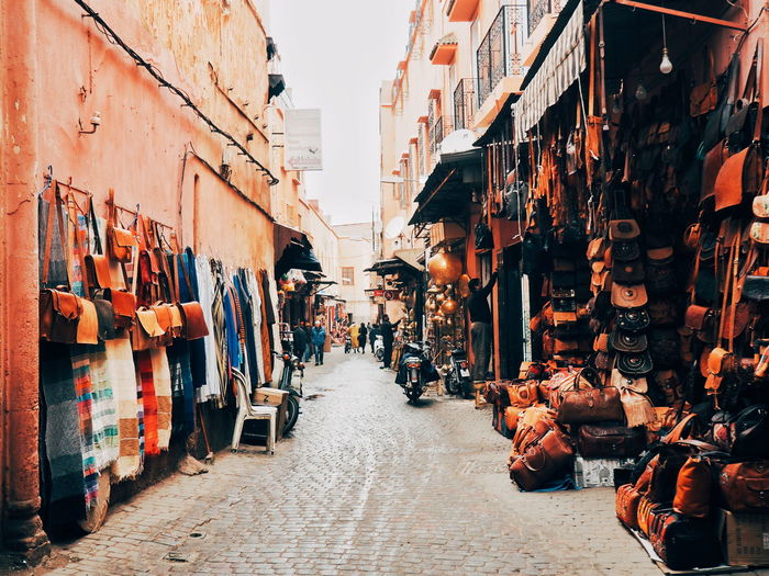 Adult Adults Only Alleyway Architecture Building Exterior Built Structure City Day Goods For Sale In A Row Leather Leather Craft Marketplace Marrakech Men Morning Morocco Outdoors People Sky Travel Destinations