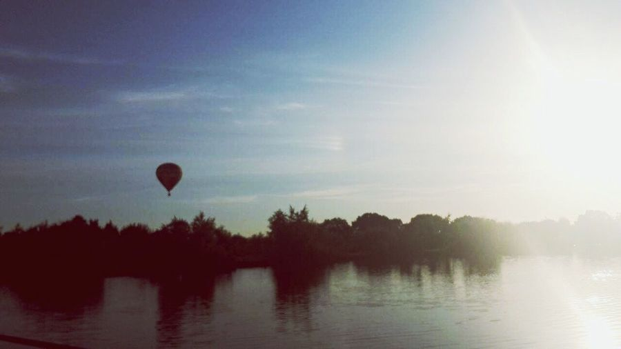 Hot air balloon 🇬🇧 Hot Air Balloon Sunbeam Water Reflection Beauty In Nature First Eyeem Photo