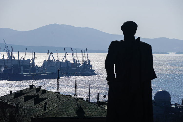 View of silhouette statue against sea
