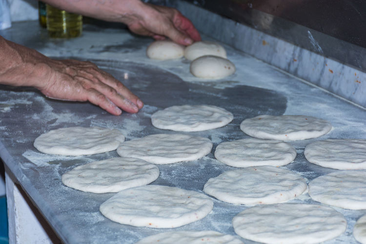 Baked Bakery Bread Close-up Day Dough Food Food And Drink Freshness Heat - Temperature High Angle View Holding Human Body Part Human Hand Kneading Making Men Occupation One Person People Preparation  Preparing Food Real People Skill  Working