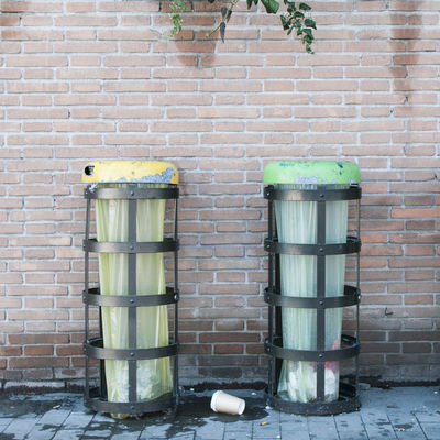 Waste Brick Wall Built Structure City Day Green Color No People Oorban Outdoors Trash Trashes Urban Waste Waste On The Street