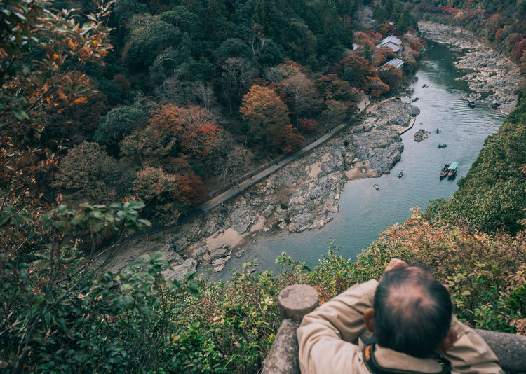 // kyoto in autumn // AMPt_community Japan Nature Shootermag EyeEm Best Shots EyeEm Nature Lover Water Leisure Activity Lifestyles Tree Real People Plant High Angle View Men Beauty In Nature One Person Day Scenics - Nature Forest River Rock Tranquility Land Outdoors Photographer