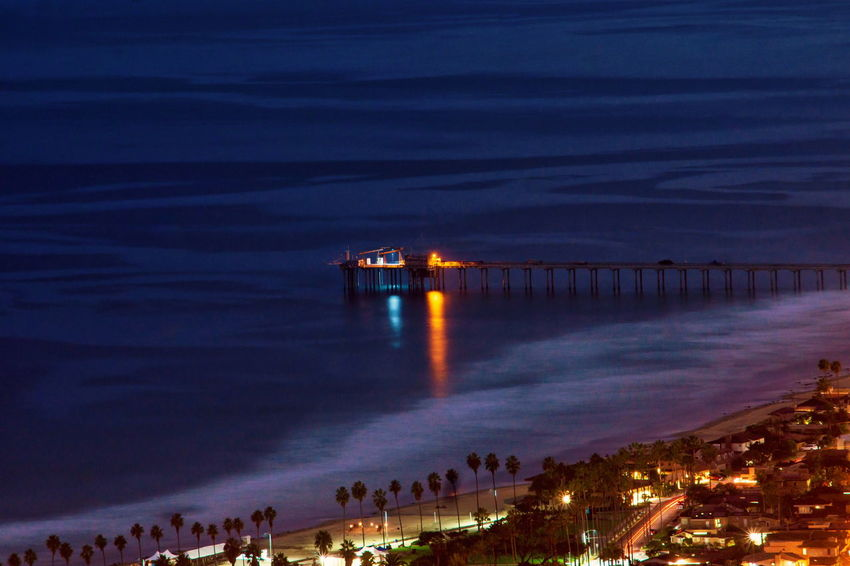 Nightphotography Pier Reflection Ocean Waves Night Lights Longexposure Surf Beach Sea Built Structure High Angle View Architecture Outdoors Horizon Over Water Water's Edge Night Nature Scenics Water