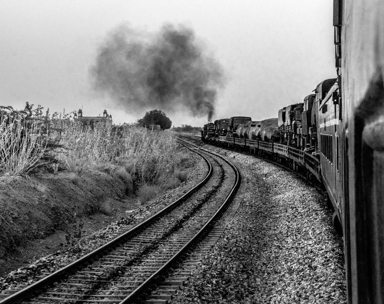 BYOPaper! Transportation Railroad Track Rail Transportation Smoke - Physical Structure Day No People Train - Vehicle Public Transportation Outdoors The Way Forward Sky Steam Train Locomotive Blackandwhite Train India Myownphotography Original Bestofmay2017 Open Spaces The Great Outdoors - 2017 EyeEm Awards Let's Go. Together.