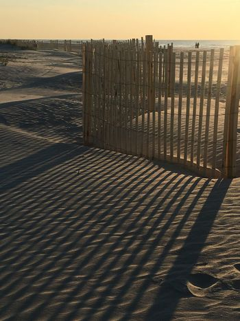 Lines Beach Safety Wood - Material Protection Sea No People Outdoors Shadow Sand Sunlight Sky Nature
