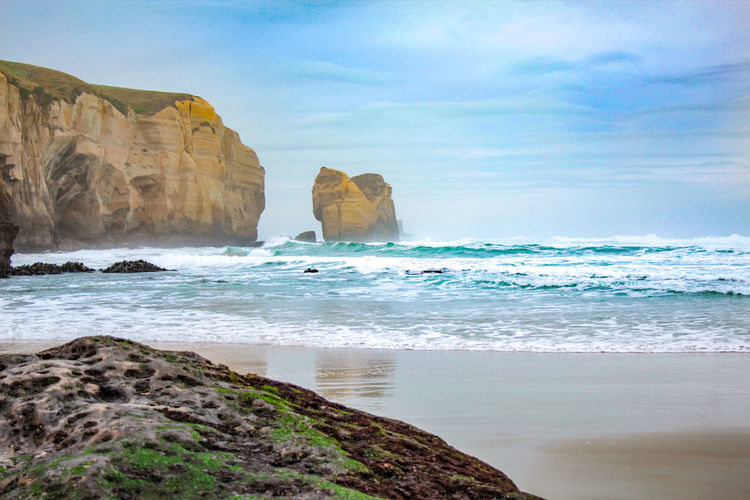 Tunnel Beach during early morning hours, near Dunedin, Otago, South Island, New Zealand New Zealand South Island Nature Outdoors Otago Otago Peninsula Dunedin Dunedin New Zealand Landscape Road Trip Travel Travel Destinations Beach Sea Ocean Seascape Tunnel Beach Morning Morning Light Cliffs Rocks Rock Formation Fog Foggy Water Rock Sky Land Rock - Object Solid Scenics - Nature Beauty In Nature Motion Wave Day Tranquility Tranquil Scene Surfing Horizon Over Water Stack Rock Eroded