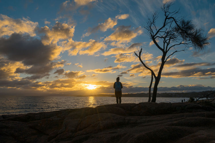 Watching the Sunset Freycinet National Park. Coles Bay Australia Beach Beauty In Nature Cloud - Sky Day Female Freycinet Freycinet National Park Full Length Horizon Over Water Nature One Person Outdoors People Real People Scenics Sea Silhouette Sky Sunset Tasmania Tranquil Scene Tranquility Water