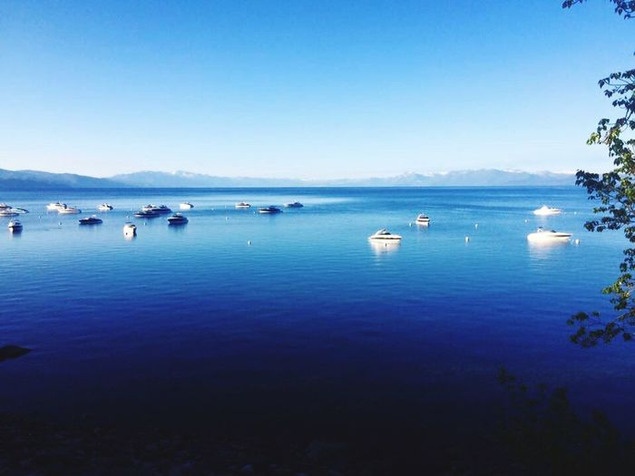 Water Blue Lake Tahoe Boats Nature Beauty In Nature Scenics Tranquility Reflection Tranquil Scene Mountain Outdoors Sky No People Beach Clear Sky