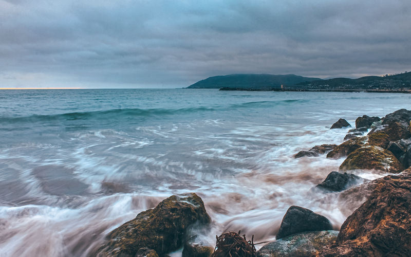 Waves Water Sea Sky Cloud - Sky Scenics - Nature Beauty In Nature Rock Land Nature Rock - Object Beach Solid Horizon Over Water Idyllic Horizon Motion No People Tranquility Tranquil Scene Outdoors Power In Nature Flowing Water