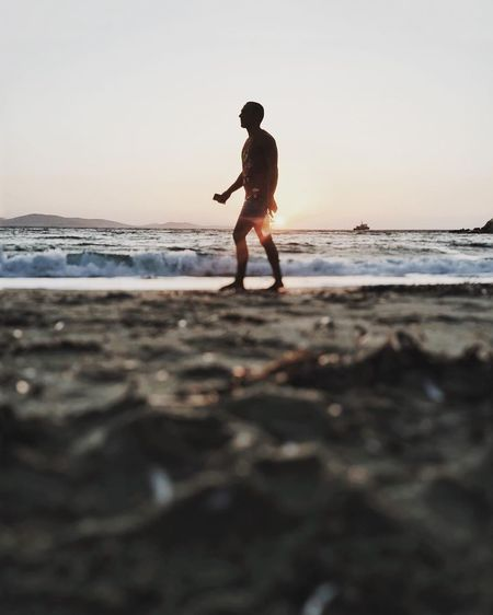 Sea Beach Full Length Sunset One Person Water Horizon Over Water Outdoors Nature Sky Scenics Silhouette Sand Vacations Beauty In Nature Standing Real People Lifestyles Wave Day Sommergefühle Summertime EyeEm Selects Vacations Summer