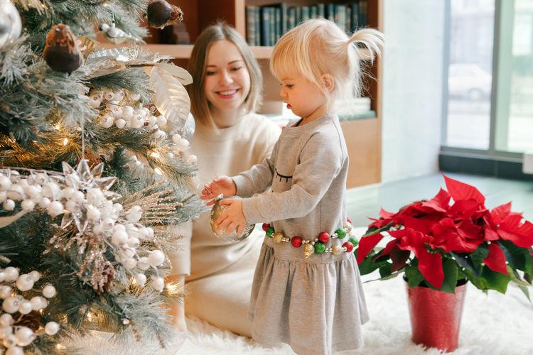 Rear view of women in christmas tree