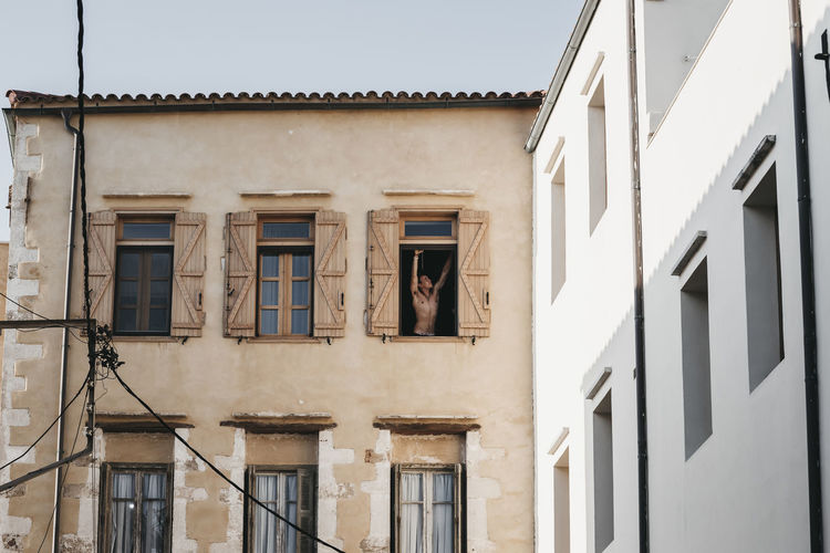 Architecture Balcony Building Building Exterior Built Structure City Clothing Day Hanging House Laundry Low Angle View Nature No People Old Outdoors Residential District Sky Sunlight Window