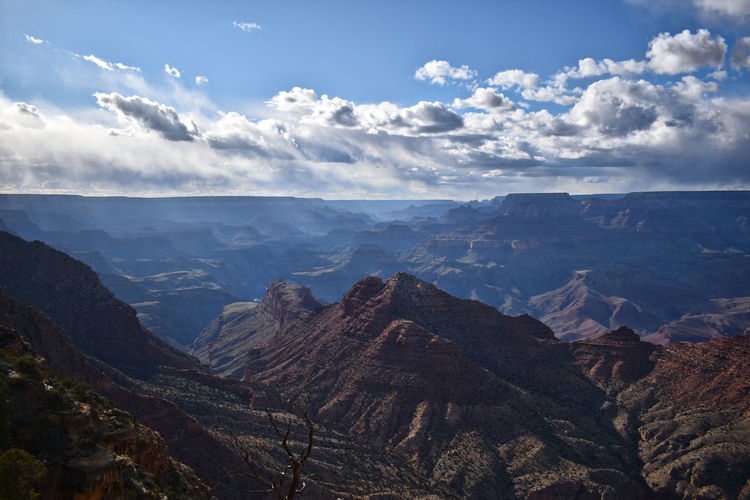 Scenic view of dramatic landscape against sky - at the grand canyon