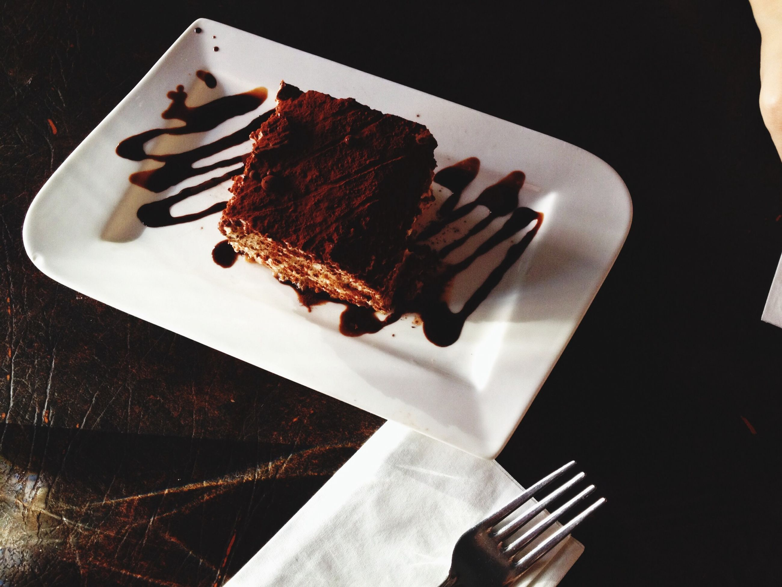 food, food and drink, indoors, still life, sweet food, ready-to-eat, indulgence, freshness, unhealthy eating, dessert, plate, table, close-up, fork, cake, chocolate, high angle view, temptation, slice, serving size