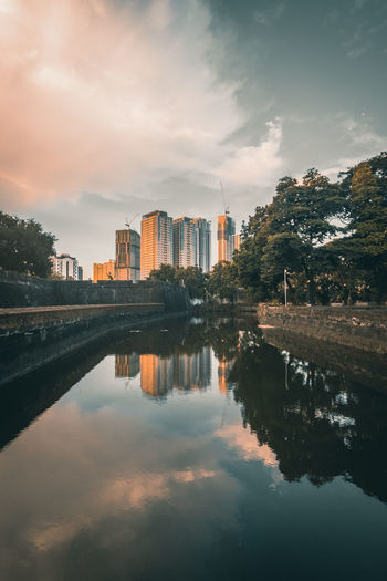 Reflection of skyscraper buildings during sunset