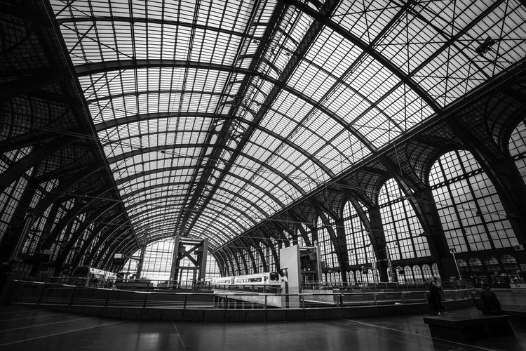 Antwerpen March 2019 EyeEm Best Shots - Black + White Antwerp Train Station Metal Construction Monochrome Blackandwhite Touristic Attraction Famous Building Train Station Historical Buildings Indoors  Built Structure Architecture Ceiling Pattern Day No People Glass - Material Transportation Roof Window Arch Travel Architectural Feature Metal Roof Beam Skylight Low Angle View