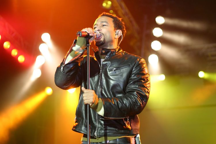 (October 29, 2005) Artist John Legend performs at Fedex Field. John Legend Fedex Field Microphone Input Device Performance Arts Culture And Entertainment Music One Person Stage - Performance Space Singing Singer  Stage Event Musician Holding Enjoyment Indoors