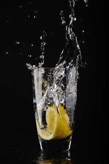 Lemon Water Water Splashing Lemon Juice Art Speed Studio Shot Water Splashing Black Background Food And Drink Refreshment Citrus Fruit Glass Indoors  Freshness Motion Fruit Drink Drinking Glass Close-up Lemon High-speed Photography