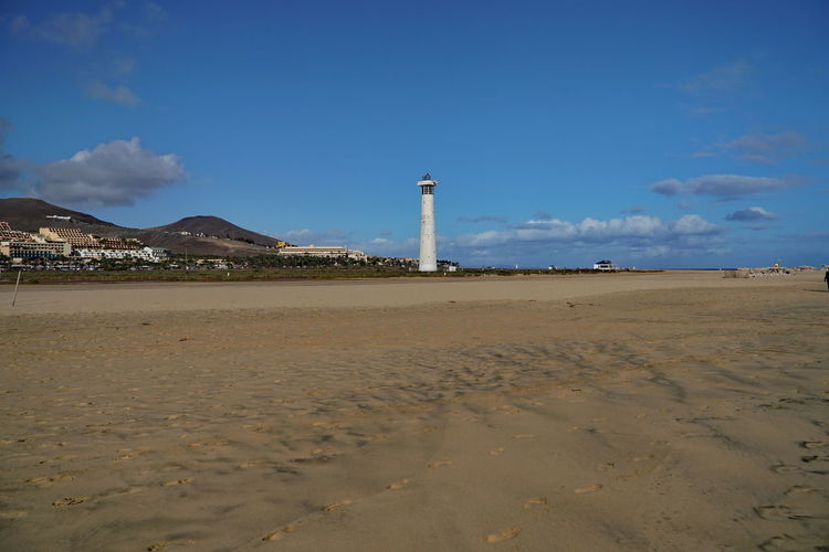 mj1 Faro De Morro Jable Fuerteventura Lighthouse Morro Jable Lighthouse Architecture Beach Beauty In Nature Built Structure Day Direction Lighthouse Nature No People Outdoors Sand Sea Sky Water