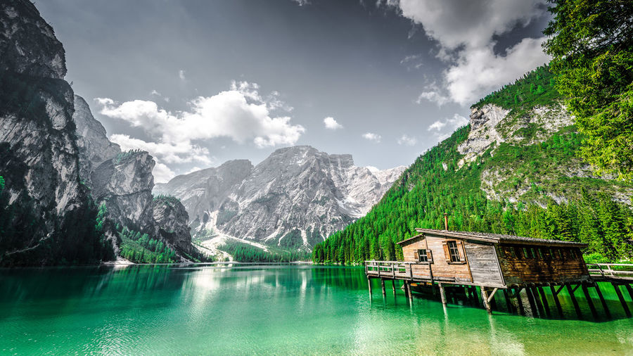 Scenic view of lago di braies and mountains against sky