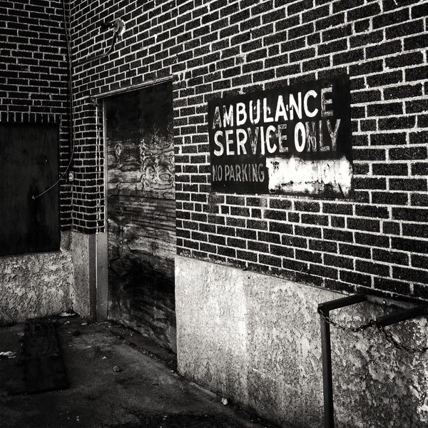 Built Structure Architecture Building Exterior Text Brick Wall Outdoors No People Day Abandoned Places Ambulance Service Monochrome Photography No Service Today