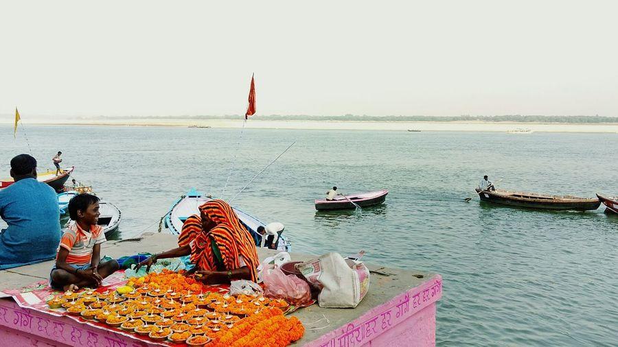 Enjoy The New Normal. Locals selling Diyas on the Occasion of DevDeepawali at Tulsi Ghat in Varanasi. Riverside Ganga Evening Smile Kid Moment Grandma EyeEm Diversity