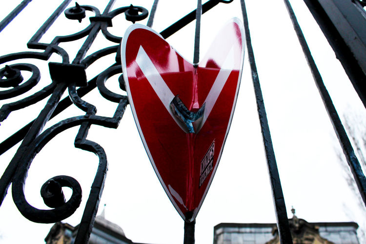 Bars Budapest Close-up Day Gate Heart Heart Shape Hungary Low Angle View No People Red Road Sign Sky Stop Stop Sign Symbol Symbolic