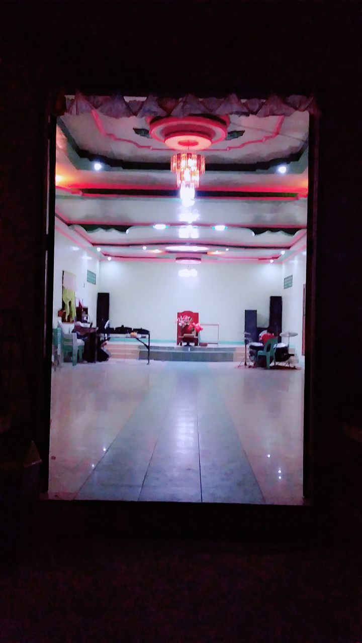 illuminated, indoors, lighting equipment, no people, flooring, night, absence, architecture, light, empty, ceiling, electric light, built structure, technology, motor vehicle, glowing, nightlife, light - natural phenomenon, reflection, mode of transportation, tiled floor, electric lamp, luxury